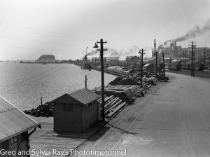Looking east across the timber wharf, Newcastle Harbour. Circa 1930s.