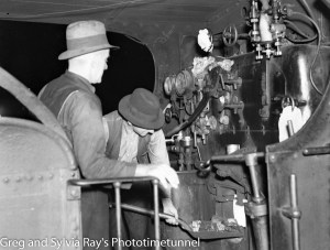 Fireman feeds the boiler in the cabin of a steam locomotive, April 13, 1938.