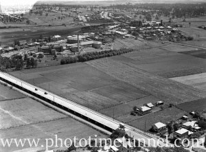 Aerial view of Maitland, NSW, showing the Long Bridge and hospital, circa 1940s. (2)