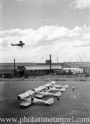 Avro Cadet aircraft at Newcastle Aero Club, 1940s, with Goninan engineering in the background.