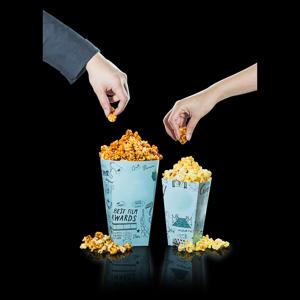 hands taking popcorns