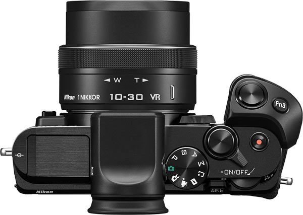 Nikon 1 V3 with  electronic viewfinder and multi-accessory grip.