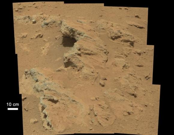 """""""Broken Sidewalk"""" image. """"NASA's Curiosity rover found evidence for an ancient, flowing stream on Mars at a few sites, including the rock outcrop pictured here, which the science team has named """"Hottah"""" after Hottah Lake in Canada's Northwest Territories. It may look like a broken sidewalk, but this geological feature on Mars is actually exposed bedrock made up of smaller fragments cemented together, or what geologists call a sedimentary conglomerate. Scientists theorize that the bedrock was disrupted in the past, giving it the titled angle, most likely via impacts from meteorites.""""  Courtesy NASA/JPL-Caltech."""