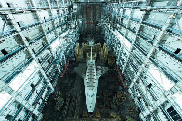 """""""This image is the result of 180 kms of off-road driving in the Kazakhstan desert, followed by 45 kms of walking in a highly restricted area. We arrived and there they were: two relics of the Soviet space race in a huge abandoned warehouse.""""   Image Credit: David de Rueda"""