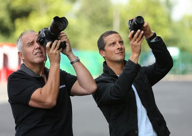 Getty Images photographer Dave Rogers (L) with Bear Grylls (R) trying out the Canon PowerShot G3 X at a Rugby World Cup match 2015 venue (Photo by Steve Bardens/Getty Images)