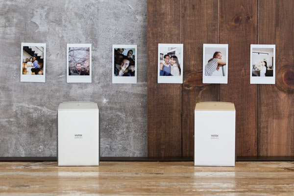Instax® SP-2 Printer: silver (left), gold (right)