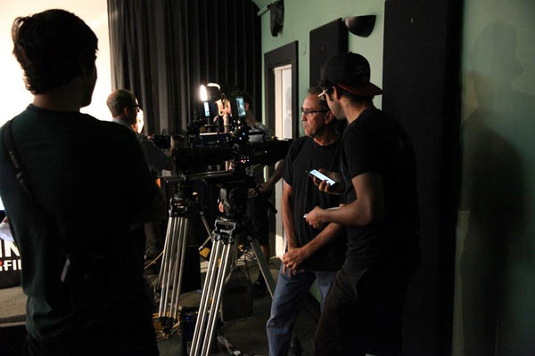 "Cinematographer Ian Ellis (with arms crossed, closest to camera) during ""FUJINON Day"" in Austin"