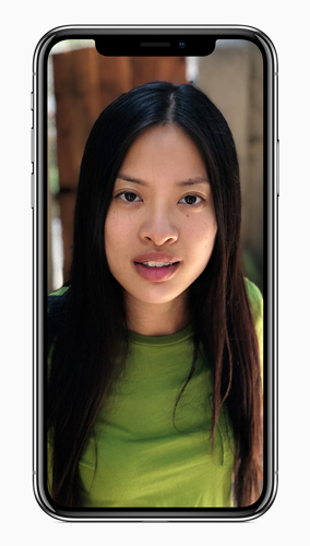 "iPhone X, Space Grey color: ""Natural Light: The subject's face is in sharp focus against a blurred background."""