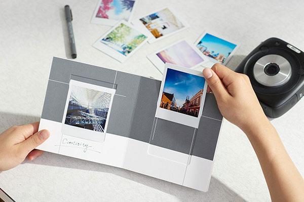 "Fujifilm instax SQUARE Picture Book: ""Create a special album for your most treasured photos. This 16-page album has a simple design with one photo per page. You can change the photos easily and write messages on each page. Great for all kinds of purposes, from travel albums to gifts."""