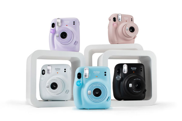 Fujifilm INSTAX Mini 11 (Clockwise): Blush Pink, Charcoal Gray, Sky Blue, Ice White and Lilac Purple