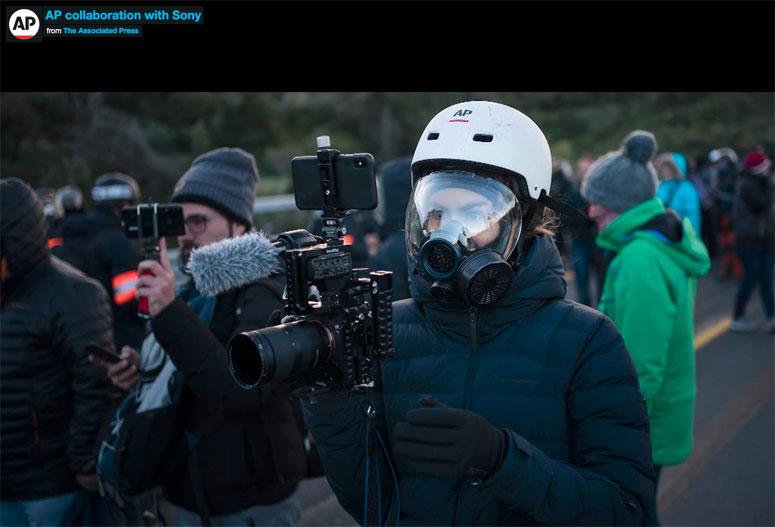 AP video journalist Renata Brito covers protests at the Spain-France border, Nov. 12, 2019, using Sony equipment. (AP Photo)