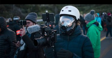 AP video journalist Renata Brito covers protests at the Spain-France border, Nov. 12, 2019, using Sony equipment. (AP Photo)