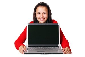 Woman showing her laptop