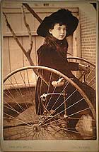 Young girl on hand powered tricycle