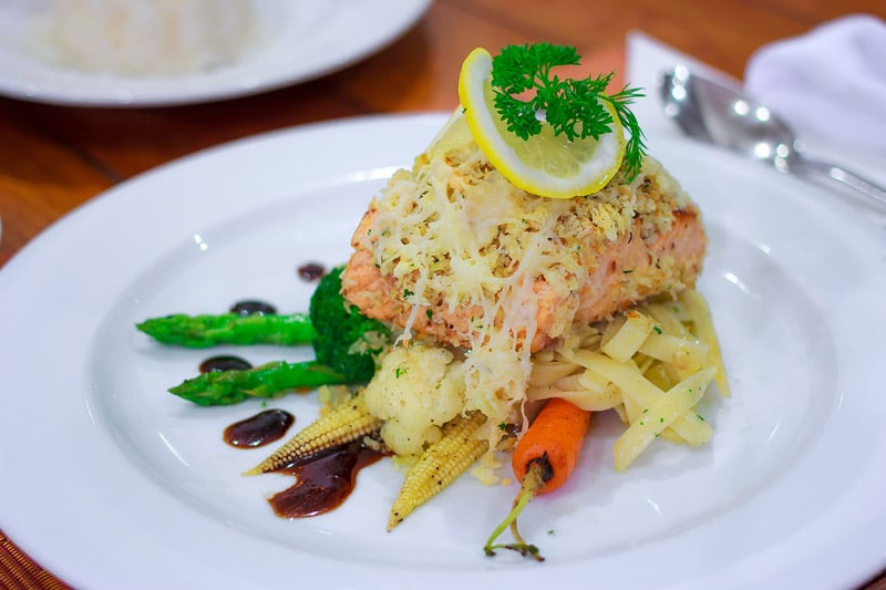 Baked salmon with the combination of rice, foods in a romantic dinner