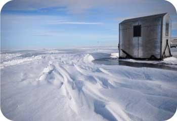 frozen lake ice house