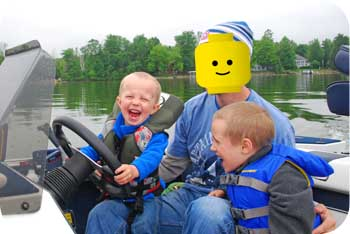 toddler driving boat