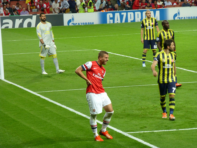 Arsenal's Lukas Podolski feels his hamstring go against Fenerbache in the Champions League - Image by Wonker (Flickr CC)