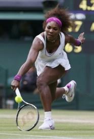 Serena Williams of the U.S. hits a return to Agnieszka Radwanska of Poland during their women's final tennis match at the Wimbledon tennis championships in London