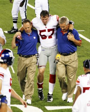 EAST RUTHERFORD, NJ - AUGUST 16: New York  Giants linebacker Chase Blackburn is injured while playing the New York Jets at the Meadowlands arena on August 16, 2010 in East Rutherford, New Jersey.