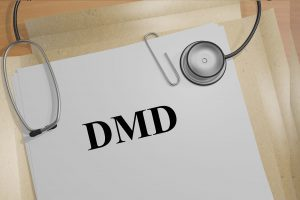 "3D illustration of ""DMD"" title on medical documents (Duchenne Muscular Dystrophy). Medicial concept."