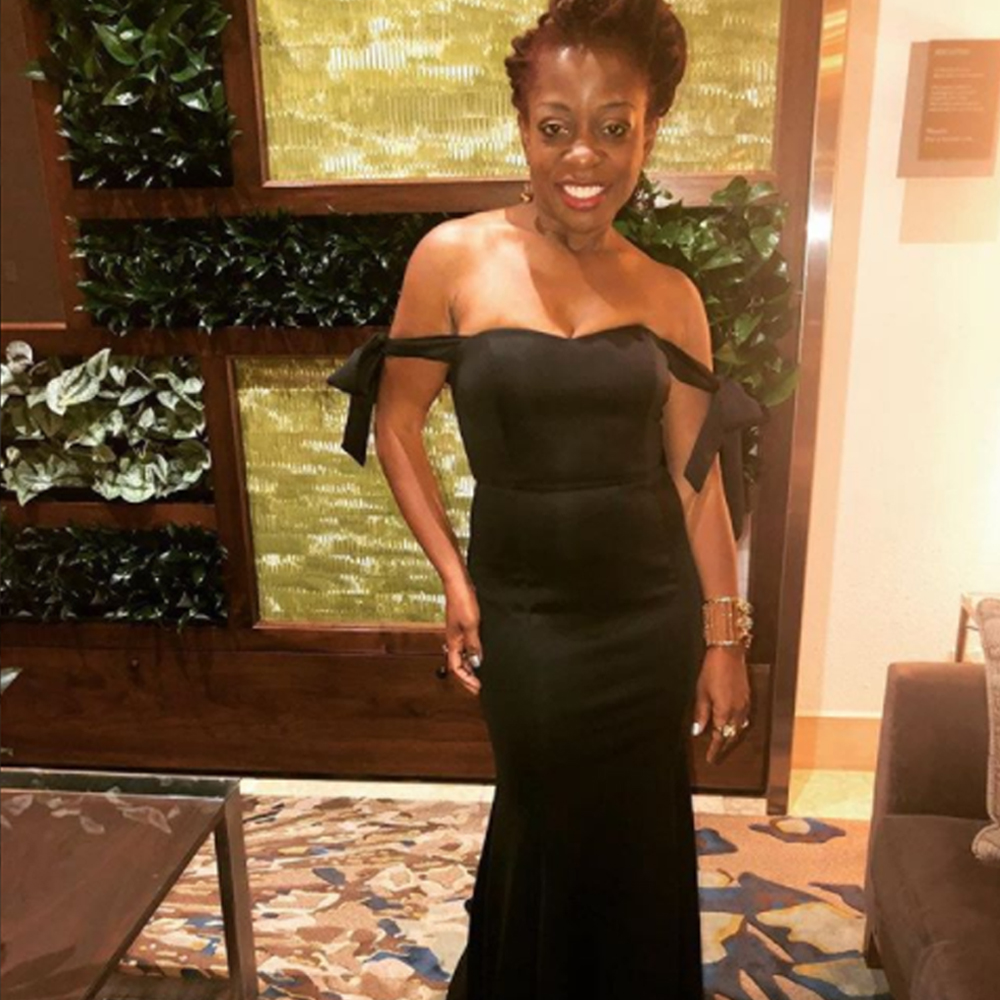 Cas sigers wearing our cressida dress during the Naacp image awards