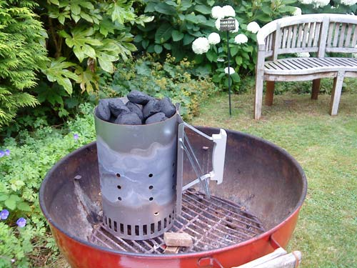 Round barbecue in the well-kept garden