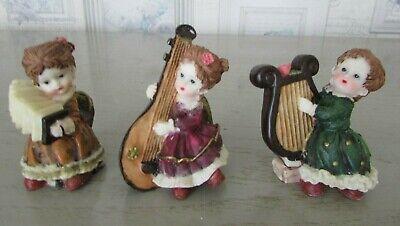 boite de 5 figurines en resine afibel harmonie musiciens hauteur environ 8 cms