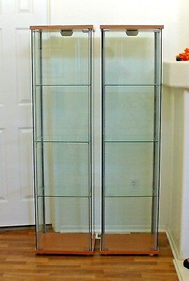 two ikea detolf glass cabinets display