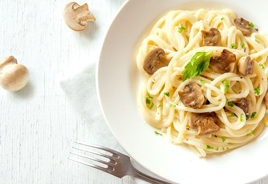 Spaghetti al taleggio e funghi