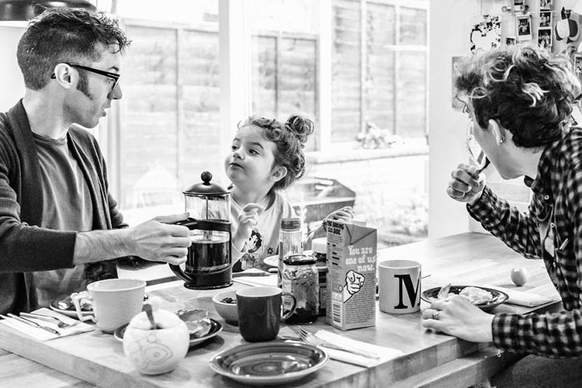 family having breakfast by documentary family photographer