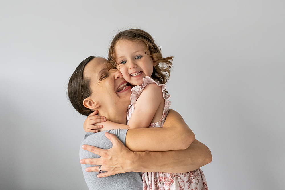 Mum and daughter hug - Family photographer in London