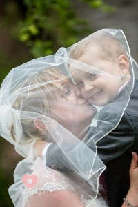 Bride and son under veil at Spittleborough Farm wedding