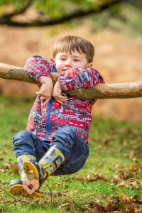 Boy left hanging in an autum woodland. Shot by swindon wedding photographer, pickin images photography