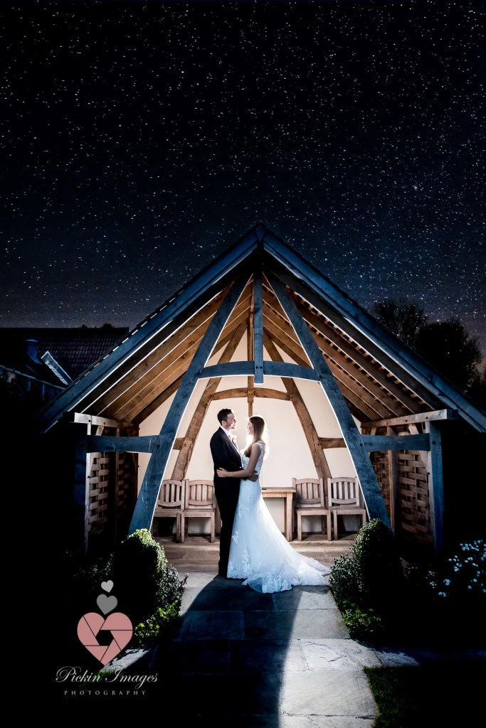 Bride and groom at Kingscoat barn under the stars night photo
