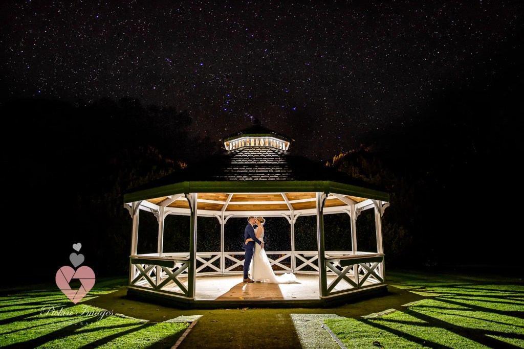Bride & Groom having a moment at Clearwell Castle in Gloucestershire. Under the stars night photo wedding.