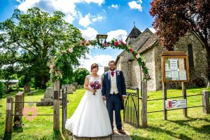 """Bride and groom at the church """"just married"""" Pickin Images Photography"""