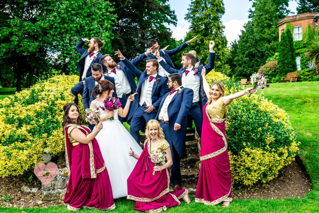 Mixed brides/groomsmen funny faces shot. Pickin Images Photography