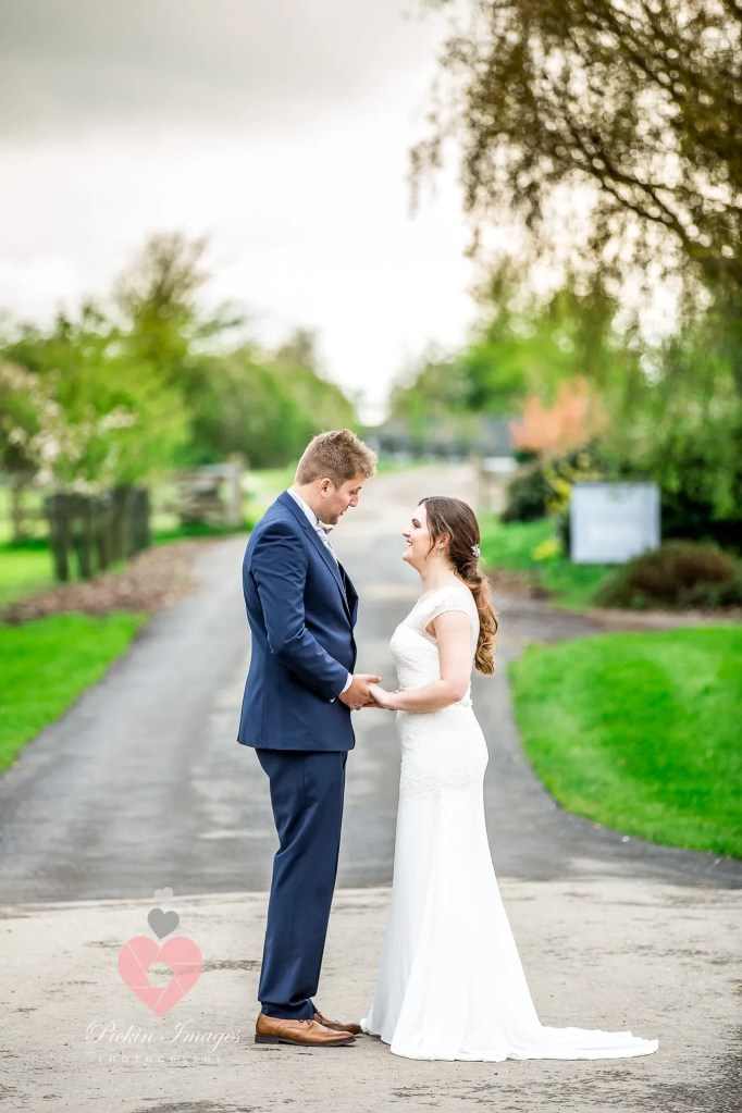 Bride and groom at Winkworth farm. Preferred photographer pickin images for photos.