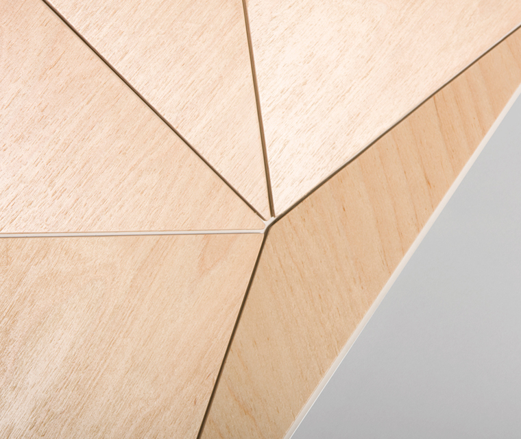 Close up of an angular plywood and white