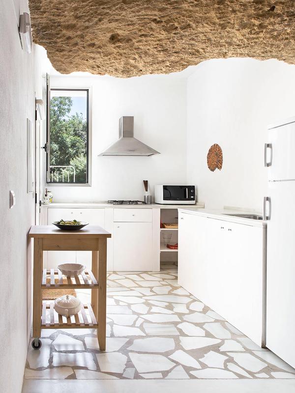 Cave house white modern kitchen