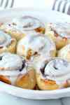 frozen bread dough made into easy cinnamon rolls with frosting and baked in a pie plate