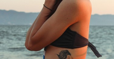 attractive Mermaid side tattoo with colorful ink for woman