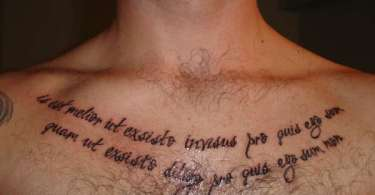Most Fantastic Glowing Latin Sayings Tattoo On Chest For Man And Woman