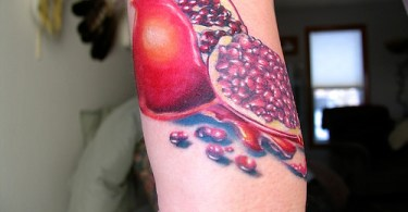 Fantastic Pomegranate Fruit Tattoo On Elbow For Girls