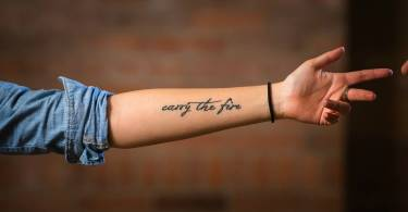 passionate  Depression Tattoo  On Arm For Boys