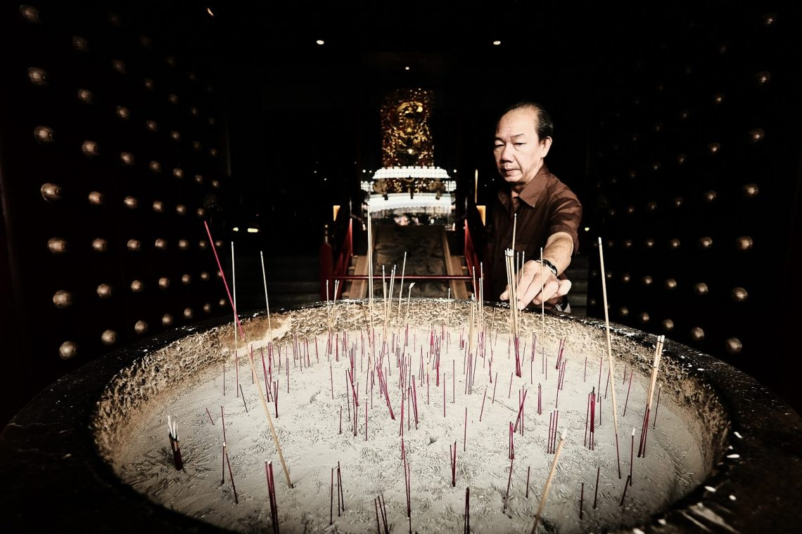 man with joss sticks
