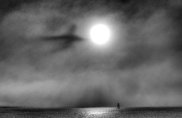 "May 6, 2013 Fog and the sun ""shadow"" a departing airliner, as seen from Winthrop,MA"