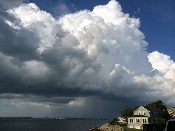 An intensifying thunderstorm exits the coast of Boston's North Shore August 7. Shot with an I phone