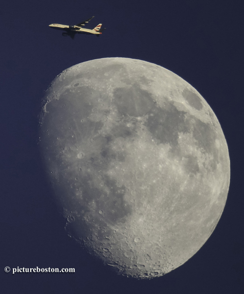 A British Airways jetliner, headed from Orlando to London, is seen over Boston Just a few days before the Supermoon